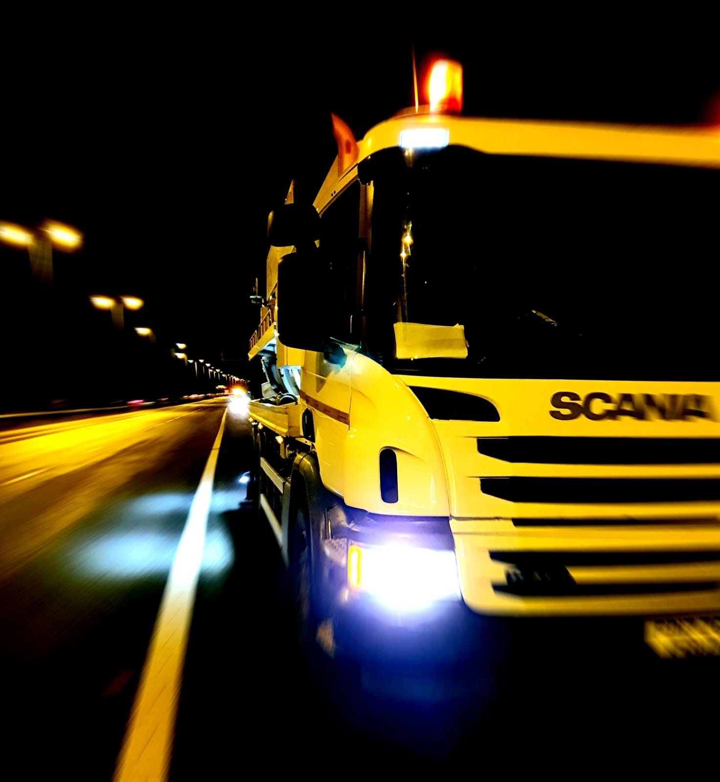Rceycler Lorry wokring on Motorway